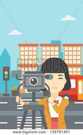 An asian young female cameraman looking through movie camera on a tripod. Young woman with professional video camera shooting in the city. Vector flat design illustration. Vertical layout.