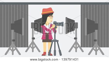 An asian young photographer working with camera on a tripod in photo studio. Woman taking photo with professional digital camera in the studio. Vector flat design illustration. Horizontal layout.