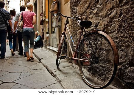 Old bicycle on the florence sreet. Italy.