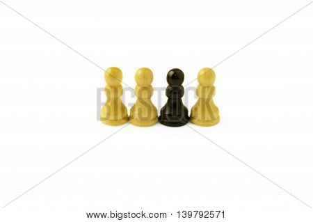one black pawn among three white ones isolated on white background