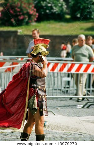 Roman legioner with cellular phone.