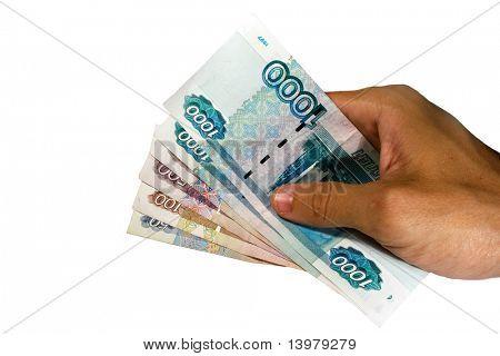 Hand holding Russian money