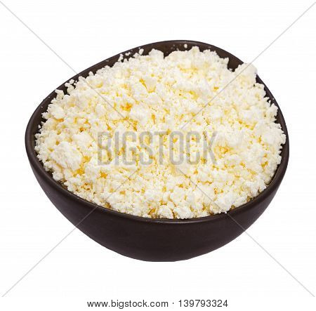 cottage cheese in a dark ceramic bowl