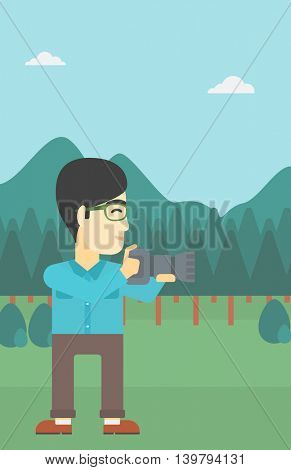 An asian young man taking a photo of landscape. Photographer taking a picture in the mountains. Nature photographer with digital camera. Vector flat design illustration. Vertical layout.