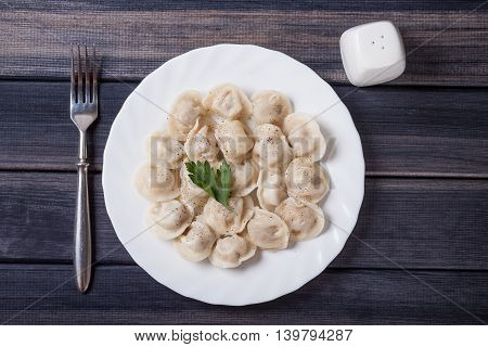 plate of hot meat dumplings on the table, top view photo still life