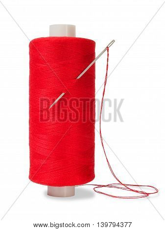 Sewing thread and needle on white background