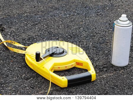 Measuring Tape isolate on Asphalt background .