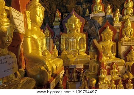 Cave with thousands of golden buddhas inside