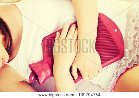 Beautiful young woman have stomach ache.