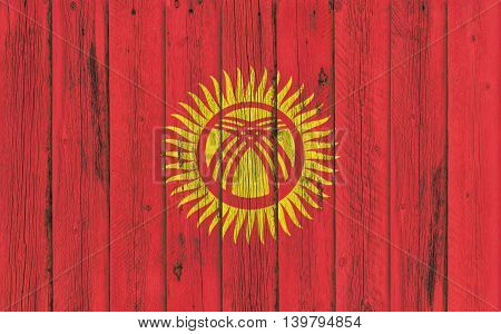 Flag of Kyrgyzstan painted on wooden frame