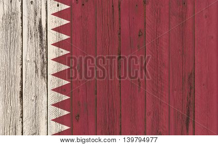 Flag of Qatar painted on wooden frame