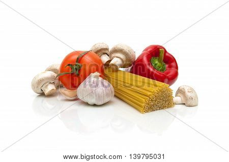 mushrooms vegetables and pasta on a white background. horizontal photo.