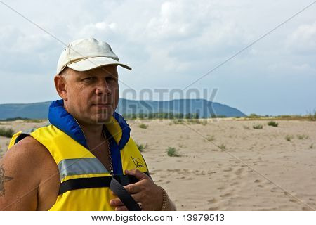 The kind rescuer in a life jacket