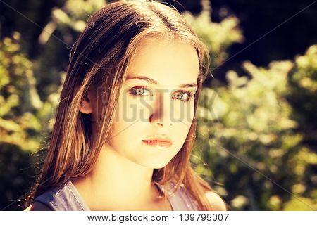 Attractive woman outdoor looking at camera.