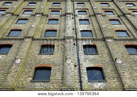 Abstract shot of an abandoned building facade, with windows blacked out