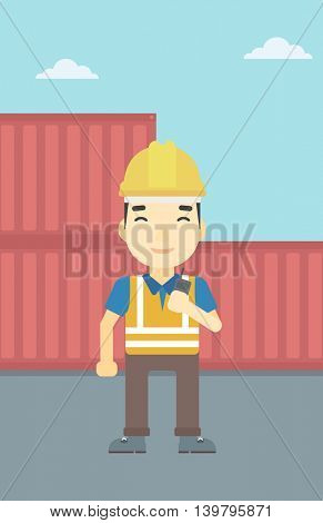 An asian port worker talking on wireless radio. Port worker standing on cargo containers background. Man using wireless radio. Vector flat design illustration. Vertical layout.