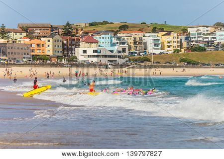 Sydney Australia - November 26 2014: Surfers in the waters of Bondi Beach. Bondi beach is one of the most famous places for surfing in Australia.