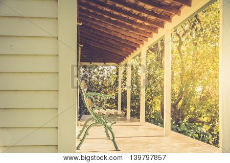 Bench in Sunshine on Deck of House Bathed in Warm Sunlight