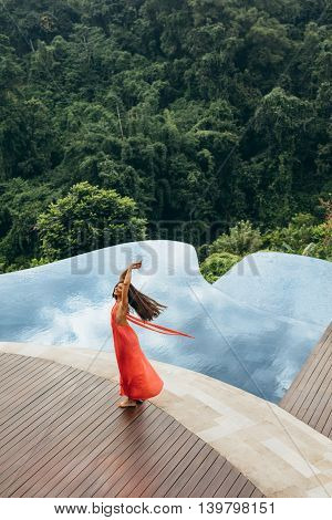 Young Woman At Poolside Looking Happy