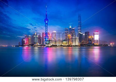 Shanghai city skyline at dusk reflection Shanghai China