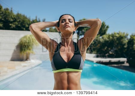 Fit Young Woman In Sports Bra At Poolside