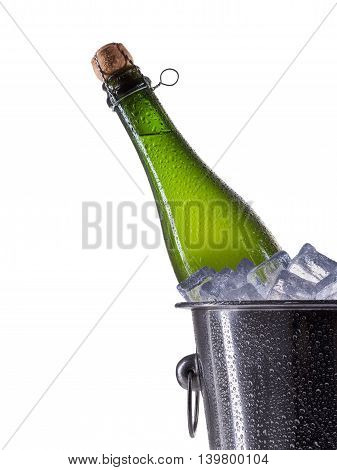 Metal champagne ice bucket with bottle isolated on a white background.