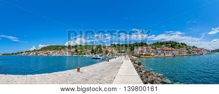 Small boats anchored in the Prvic Luka port in Croatia, panoramic view from the the main pier.