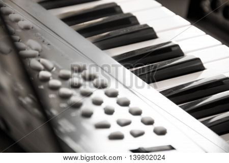 Piano Keys part of digital midi keyboard close up. roll. Synth for learning to play Musical concept classical music black and white