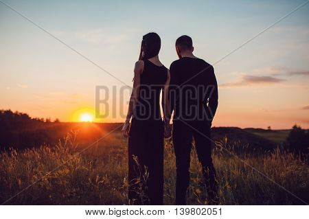 The guy with the girl at sunset