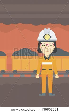An asian confident coal miner. A female miner in hardhat with torch. Miner standing on the background of mining tunnel with cart full of coal. Vector flat design illustration. Vertical layout.
