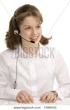Female Receptionist With Headphones, Typing, Communicating 1