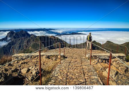Tourist Man Standing On The Highest Point Of Madeira