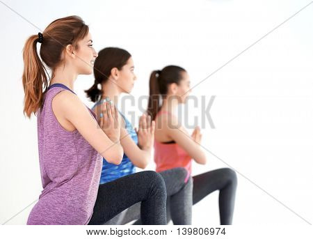 Young women with mats in gym