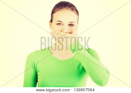 Attractive woman covering her mouth.