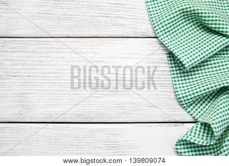 Green napkin on the old wooden background