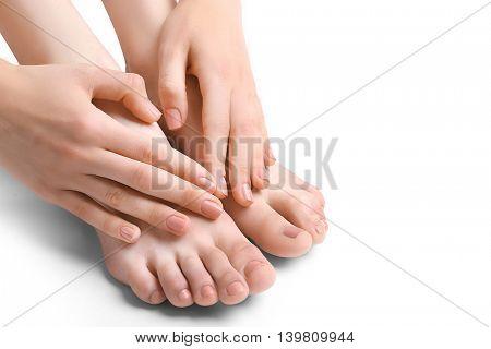 Female feet treatment, isolated on white