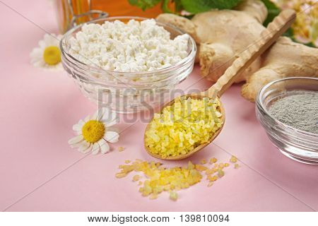 Natural ingredients for skin care on pink background