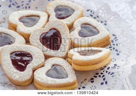 cookies from the pastry with raspberry jam delicious cookies with powdered sugar and jam