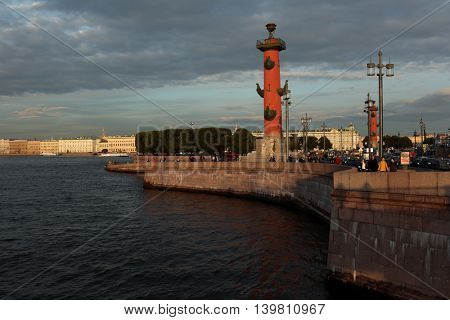 ST. PETERSBURG, RUSSIA - JUNE 10, 2016: People on the spit of Vasilyevsky Island at Rostral columns The columns was built in 1810 by design of French architect Jean-Francois Thomas de Thomon