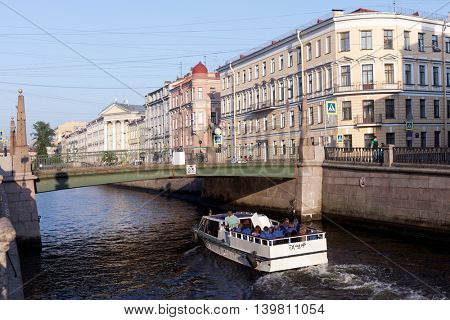 ST. PETERSBURG, RUSSIA - MAY 29, 2016: People on the tour boat in Griboyedov canal. River tours is the favorite leisure activity in the city with more than 50 rivers
