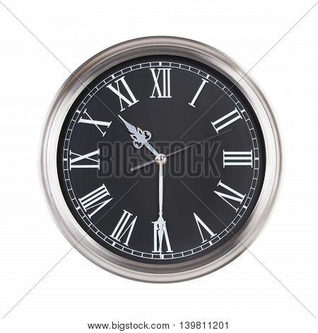 Half past ten on the round clock