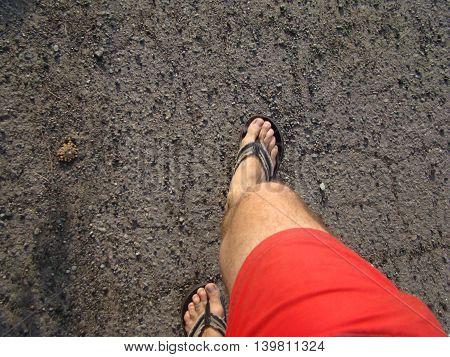 view of feet from the top while walking