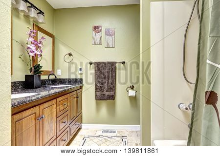 Cozy Bathroom Interior In Ivory Tones With Orchid Pot