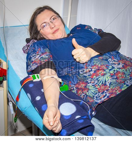 Intravenous Infusion Therapy On Mature Woman