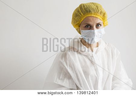 Portrait of blonde woman in protective suit. Scientist or farm worker