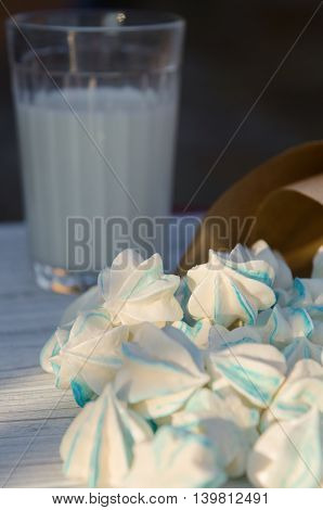 small sugar cookies and a glass of milk