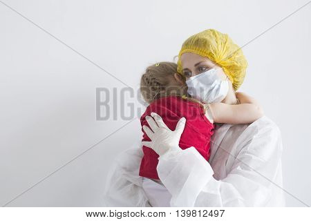 Woman scientist hugs and calm her young daughter