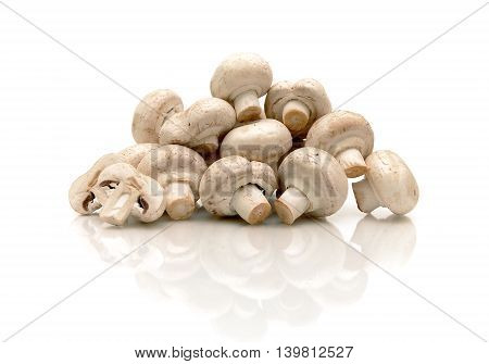 champignons on a white background with reflection. horizontal photo.