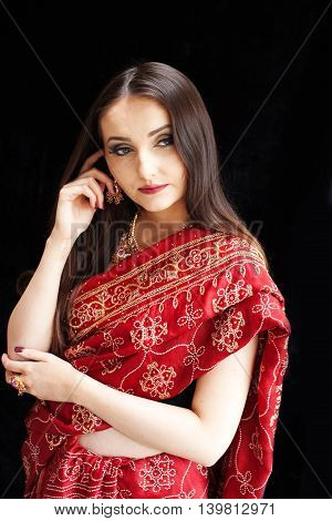 Beautiful Indian woman wearing red and gold sari