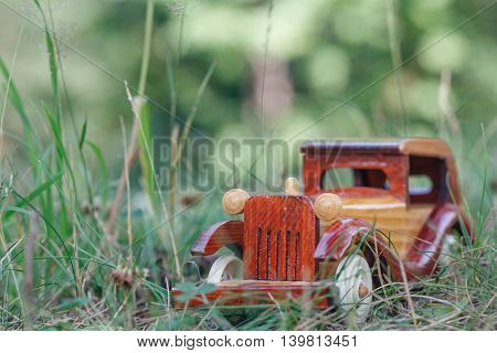 Small Wooden Toy Car In Forest